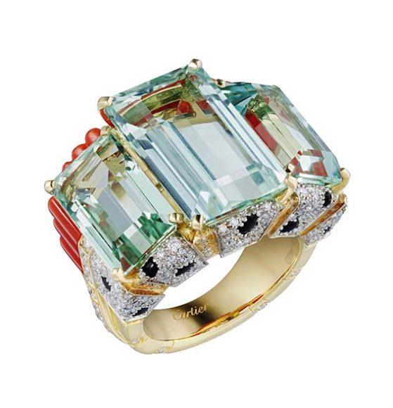 Cartier Bague Panthère Tropicale  Collection (Sur)Naturel En or jaune, aigues-marines octogonales, corail, onyx, diamants taille brillant.